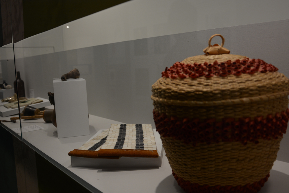 The first display case in the newly renovated museum at the Co-cathedral in Longueuil introduces visitors to the original residents of the area including Kanienkehá:ka ancestors. (Daniel J. Rowe, The Eastern Door)